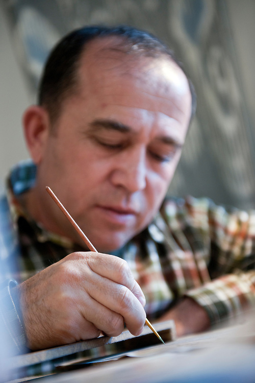 Bukhara, Uzbekistan 24 March 2012<br /> Bukharian artist Davron Toshev paints a miniature in his atelier.<br /> Bukhara of the 16th century attracted skilled craftsman of calligraphy and miniature-paintings making of this region the hub of arts.<br /> PHOTO: EZEQUIEL SCAGNETTI