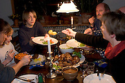 (MODEL RELEASED IMAGE). Serving potatoes, vegetables and rouladen (a traditional German entree) at a dinner party in the Melander's dining room. Rouladen is a favorite meat dish of the family. (Supporting image from the project Hungry Planet: What the World Eats.)