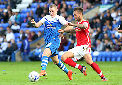Peterborough United's Marcus Maddison is fouled by Barnsley's James Bailey - Photo mandatory by-line: Joe Dent/JMP - Mobile: 07966 386802 - 18/10/2014 - SPORT - Football - Peterborough - London Road Stadium - Peterborough United v Barnsley - Sky Bet League One