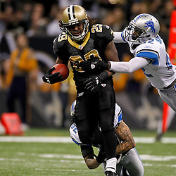 January 7, 2012; New Orleans, LA, USA; New Orleans Saints running back Chris Ivory (29) is tackled by Detroit Lions linebacker Justin Durant (52) and Detroit Lions safety Amari Spievey (42) during the 2011 NFC wild card playoff game at the Mercedes-Benz Superdome. Mandatory Credit: Derick E. Hingle-US PRESSWIRE