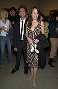 Brian Grazer and Gigi Lavangeie Grazer. Jeff Koons exhibition opening and dinner. Gagosian Gallery and Mr. Chow. Los Angeles. 22 March 2001. © Copyright Photograph by Dafydd Jones 66 Stockwell Park Rd. London SW9 0DA Tel 020 7733 0108 www.dafjones.com