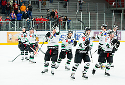Players of Olimpija celebrate after the ice hockey game between Team Jesenice and HDD Telemach Olimpija in 1st leg of Finals of Slovenian National Championship 2014, on March 31, 2014 in Arena Podmezakla, Jesenice, Slovenia. Photo by Vid Ponikvar / Sportida