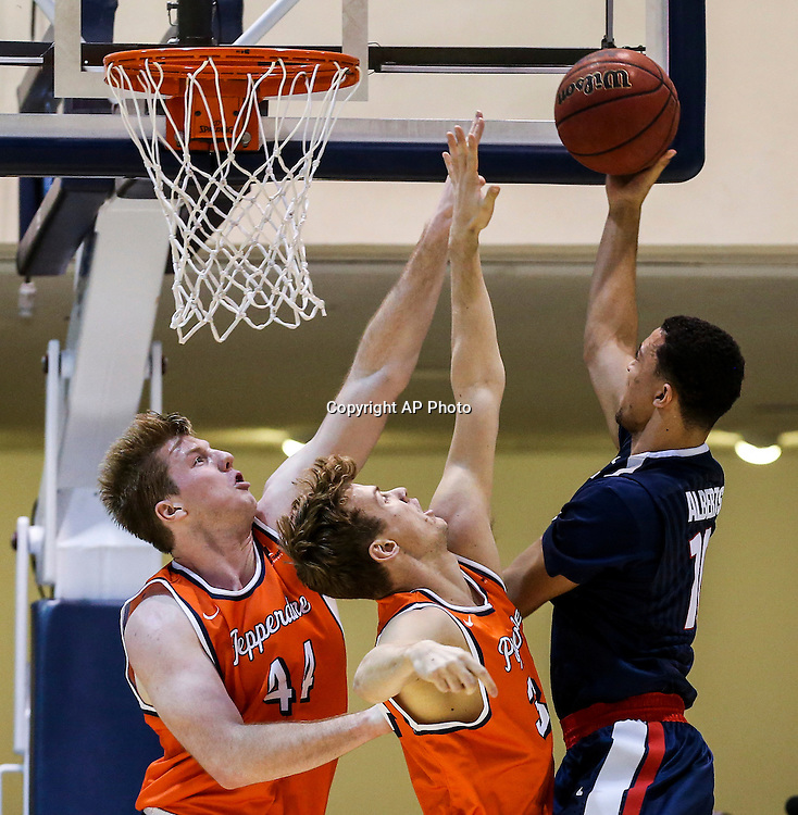 Gonzaga guard Bryan Alberts, right, goes up for a shot against Pepperdine center Ryan Keenan, left, and guard Jeremy Major during the second half of an NCAA college basketball game, Saturday, Jan. 28, 2017, in Malibu, Calif.. Gonzaga won 96-49.  (AP Photo/Ringo H.W. Chiu)