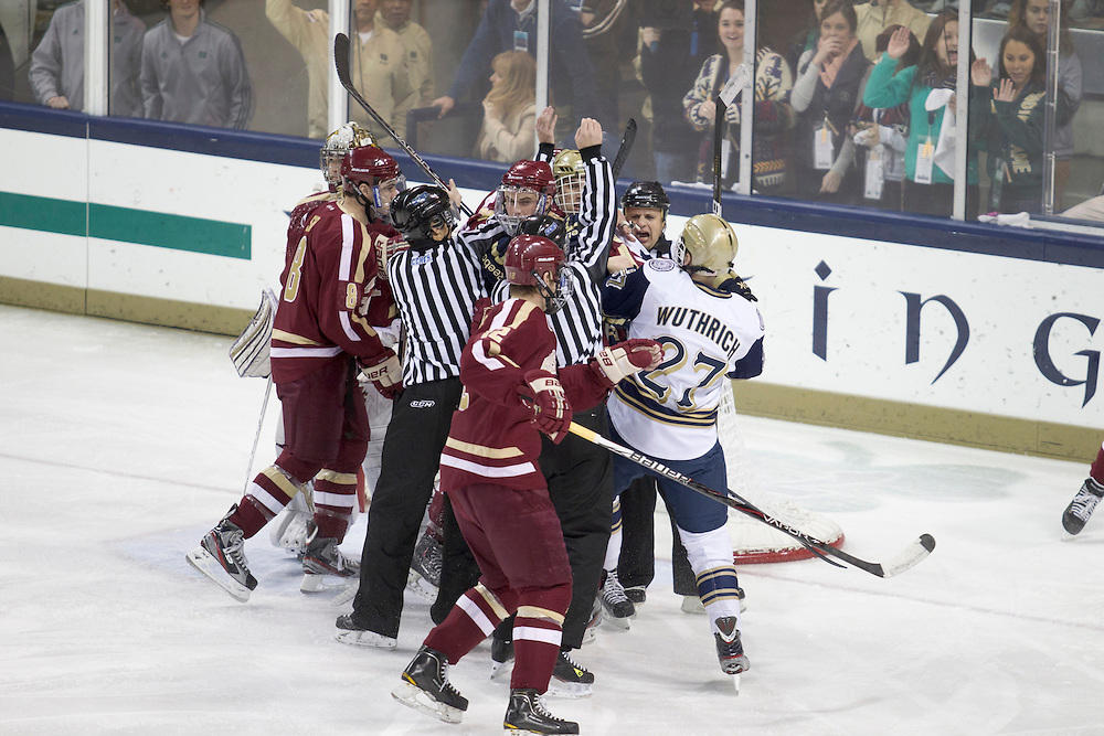 Boston College and Notre Dame players scuffle in action during NCAA hockey game between Notre Dame and Boston College.  The Notre Dame Fighting Irish defeated the Boston College Eagles 3-2 in game at the Compton Family Ice Arena in South Bend, Indiana.