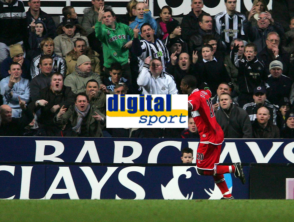 Photo: Andrew Unwin.<br />Newcastle United v Middlesbrough. The Barclays Premiership. 02/01/2006.<br />Middlesbrough's Yakubu incurs the wrath of the Newcastle supporters as he celebrates his goal.