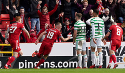 Aberdeen's Lewis Ferguson celebrates scoring their side's first goal of the game during the cinch Premiership match at Pittodrie Stadium, Aberdeen. Picture date: Sunday October 3, 2021.