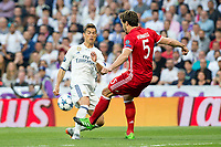 Cristiano Ronaldo of Real Madrid competes for the ball with Mats Hummels of FC Bayern Munchen during the match of Champions League between Real Madrid and FC Bayern Munchen at Santiago Bernabeu Stadium  in Madrid, Spain. April 18, 2017. (ALTERPHOTOS)