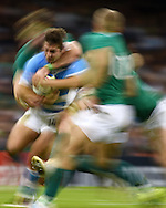 a pan blur image as Santiago Cordero of Argentina  is held up by the Ireland defence. Rugby World Cup 2015 quarter-final match, Ireland v Argentina at the Millennium Stadium in Cardiff, South Wales  on Sunday 18th October 2015.<br /> pic by  Andrew Orchard, Andrew Orchard sports photography.