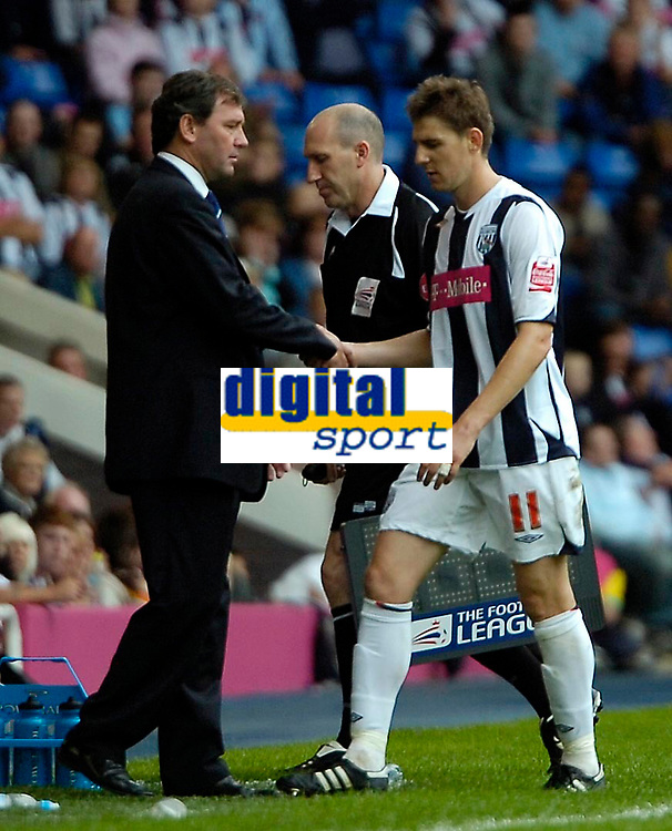Photo: Ed Godden.<br />West Bromwich Albion v Colchester United. Coca Cola Championship. 19/08/2006. Albion Manager Bryan Robson (L) takes off Zoltan Gera in the second half.