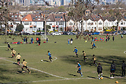 With the wider city in the distance, youth teams play a football match in a south London park, on 17th April 20231, in London, England.