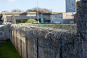 Security fencing inside HMP/YOI Portland, a resettlement prison with a capacity for 530 prisoners. Dorset, United Kingdom.