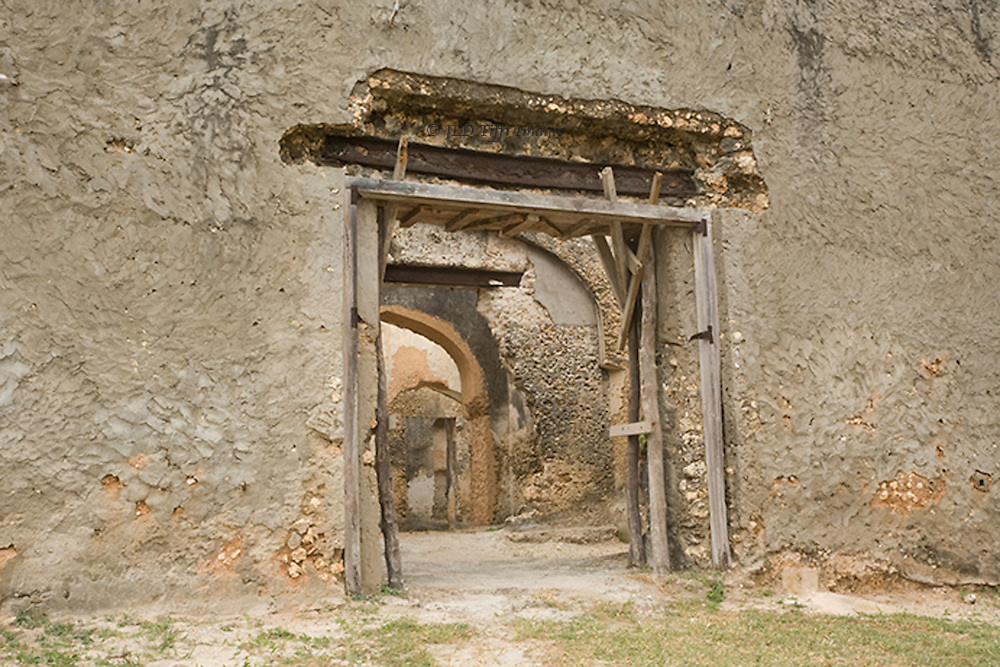 Ruins of Mtoni Palace, built by Sultan Seyyid Said to get  his Persian wife to move to Zanzibar.  View of main entrance from the outside.