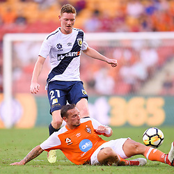 BRISBANE, AUSTRALIA - MARCH 31: Kye Rowles of the Mariners is tackled by Eric Bautheac of the Roar during the Round 25 Hyundai A-League match between Brisbane Roar and Central Coast Mariners on March 31, 2018 in Brisbane, Australia. (Photo by Patrick Kearney / Brisbane Roar FC)