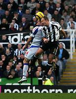 Photo: Andrew Unwin.<br />Newcastle United v Blackburn Rovers. The Barclays Premiership. 21/01/2006.<br />Newcastle's Alan Shearer (R) competes with Blackburn's Ryan Nelsen (L).