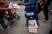 A week after the 9-11 terrorist attack on the Twin Towers and the Pentagon, a newspaper vendor sells copies of the New York Daily News with the face of Osama bin Laden and a cowboy-era outlaws headline of Dead or Alive, on 18th September 2001, New York, USA.