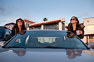 Students Alisa and Charlotte watch the sunset from their car at Windansea Beach in La Jolla, Jan. 7, 2011.
