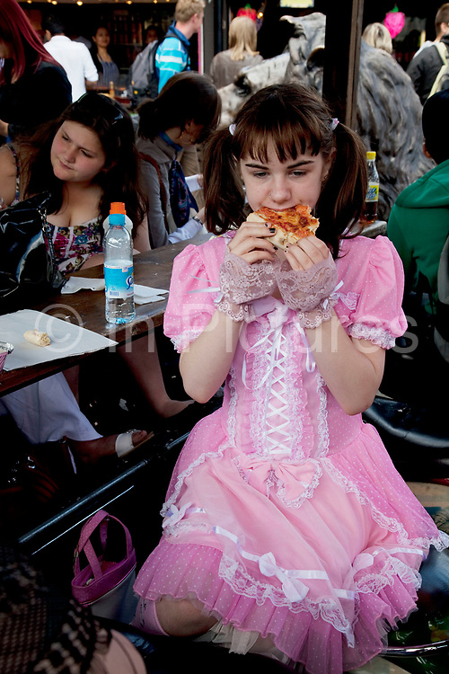 Georgia (11, wearing a pink Lolita dress) spending a day out together in Camden Town, North London. Her family can afford to have a simple lunch of pizza in the food market. Louise (her mother) is on various benefits to help support her family income, and housing, although recent government changes to benefits may affect her family drastically, possibly meaning they may have to move out of London. Louise Ryan was born on the Wirral peninsula in 1970.  She moved to London with her family in 1980.  Having lived in both Manchester and Ireland, she now lives permanently in North London with her husband and two children. Through the years Louise has battled to recover from a serious motorcycle accident in 1992 and has recently been diagnosed with Bipolar Affective Disorder. (Photo by Mike Kemp/For The Washington Post)