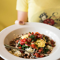 """A waitress holds a dish of the """"veggie breakfast bowl"""" at the Early Girl Eatery, a self-described """"farm to table southern comfort food experience."""" It is located at 8 Wall Street in Downtown Asheville, North Carolina."""