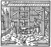 Stamp for breaking copper cupellation cakes for further refining, powered by water wheel through drive shaft . From Agricola 'De re matallica', Basle, 1556. Woodcut