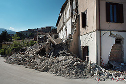© London News Pictures. 25/08/2016. Amatrice, Italy. Earthquake damage is seen at a house in the town of Amatrice in central Italy where a 6.2-magnitude earthquake destroyed towns in the area. The death toll is currently at 247 with dozens of people still missing. Thousands of rescuers continue efforts to find survivors. Photo credit: Mario Sabatini/LNP
