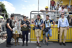 July 11, 2018 - Quimper, FRANCE - Illustration picture shows armed policemen, photographers and Christian Prudhomme, cycling director of ASO (Amaury Sport Organisation) after the arrival of the fifth stage of the 105th edition of the Tour de France cycling race, from Lorient to Quimper (204,5 km), in France, Wednesday 11 July 2018. This year's Tour de France takes place from July 7th to July 29th. BELGA PHOTO YORICK JANSENS - FRANCE OUT (Credit Image: © Yorick Jansens/Belga via ZUMA Press)