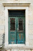 Wooden door with elegant wrought-iron screen. Dubrovnik, Croatia