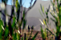 ROBERTSON, SOUTH AFRICA - MARCH 20: Riders descend into a valley during stage two's 110km from Robertson on March 20, 2018 in Cape Town, South Africa. Mountain bikers from across South Africa and internationally gather to compete in the 2018 ABSA Cape Epic, racing 8 days and 658km across the Western Cape with an accumulated 13 530m of climbing ascent, often referred to as the 'untamed race' the Cape Epic is said to be the toughest mountain bike event in the world. (Photo by Dino Lloyd)