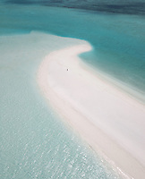 Aerial view of someone on a Sand Bar, surrounded by turqouise clear water in the Maldives, Indian Ocean