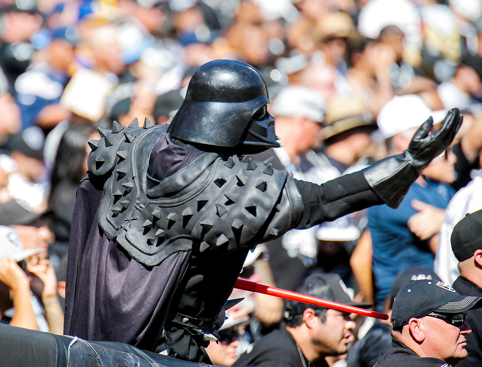 Oct 09 2016 - Oakland U.S. CA - Oakland Raiders fan as Darth Vader during the NFL Football game between San Diego Chargers and the Oakland Raiders 34-31 win at O.co Coliseum Stadium Oakland Calif. Thurman James