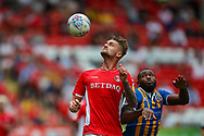 Charlton Athletic defender Patrick Bauer (5) heads the ball away from Shrewsbury Town forward Lenell John-Lewis (14) during the EFL Sky Bet League 1 match between Charlton Athletic and Shrewsbury Town at The Valley, London, England on 11 August 2018.