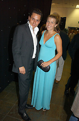 NICK GOLD and AMBER NUTTALL at the opening party of the new Frankie's Bar & Grill at Selfridges, Oxford Street, London on 6th September 2006.<br /><br />NON EXCLUSIVE - WORLD RIGHTS