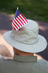 hat on a man with a plastic American flag