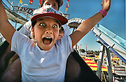 A screaming Petrena Toledo 9, rides the Hydro Slide at the California State Fair with her aunt Jennifer Dobson and cousin Matthew Dobson 4.  All are from Fair Oaks visiting the opening day of the California State Fair.