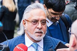 London, December 04 2017. United Breweries and Force India F1 boss Vijay Mallya outside Westminster Magistrates Court as a fire alarm disrupts his extradition hearing. He is wanted by Indian authorities to answer fraud charges. © Paul Davey