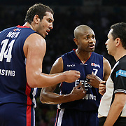 Efes Pilsen's Charles SMITH (C), Kaya PEKER (L) and Referee's Mehmet KESERATAR (R) during their Turkish Basketball league Play Off Final Sixth Leg match Fenerbahce Ulker between Efes Pilsen at the Abdi Ipekci Arena in Istanbul Turkey on Wednesday 02 June 2010. Photo by Aykut AKICI/TURKPIX