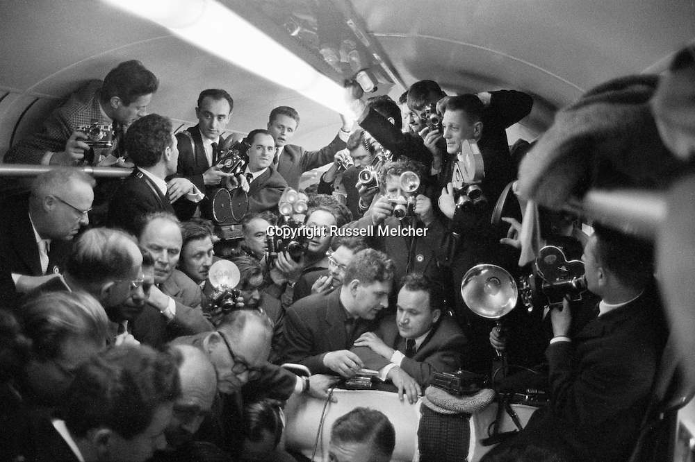 1960. Impromptu  press conference in dining car of french train on the way to Verdun.<br /> I was the only photographer allowed<br /> behind Khrushchev during the press conference.<br /> AP put out a picture of this conference where I can be seen standing behind Kruschev rewinding the film in my camera.<br /> I ran through the dining car, announcing the press conference, and that's how I got there first.<br /> <br /> 1960. Conférence de presse impromptu dans le wagon du train français en route  pour Verdun .<br /> Je suis le seul photographe autorisé<br /> derrière Khrouchtchev lors de la conférence de presse .<br /> Associated Press a pris une photo de cette conférence où je peux être vu debout derrière Kruschev  en train de rembobiner le film dans mon appareil photo .<br /> J'ai courus à travers la voiture-restaurant, annonçant la conférence de presse, et c'est comme ca que  je suis arrivé en premier.