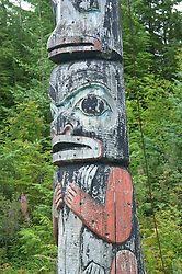 Alaska, Cruising the Southeast wilderness waterways on the Spirit of Discovery. Visit to Tlingit native village of Kake, population 800.  Photos of clothing design, jewelry, totem pole, bear, wood carver, world tallest totem pole at 132 feet, dances, male dancer (model released) and houses.Photo copyright Lee Foster, 510/549-2202, lee@fostertravel.com, www.fostertravel.com.
