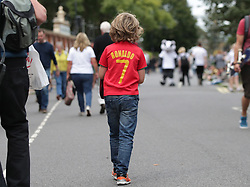 A young fan wearing a Ronaldo shirt arriving to Craven Cottage