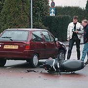 Ongeval Ceintuurbaan - Nieuwe Engweg Huizen, auto - scooter