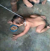 Child who was filmed being dragged around on a LEASH by his mother is taken into care after she turned herself in to social services when she saw negative feedback in the Philippines <br /> <br /> A child who was filmed being dragged around on a leash by his mother in the Philippines has been taken into care after there was an online backlash when she posted the footage online.<br /> The woman handed herself in to social services when Facebook users lambasted her over the horrifying images, in which the naked young boy is crouched over a bowl of what appears to be dog food.<br /> The photos were spotted by child abuse campaigner Lurleen Hilliard. <br /> Lurleen, 46, from Dublin, is the founder of Nolonger Victims, a global organisation that educates people on all forms of abuse and helps to protect and rescue victims. <br /> <br /> She said: 'I was trawling through Facebook on Monday when I came across the images she had posted on her page. <br /> 'Initially I was infuriated and my blood was literally at boiling point. This cannot be tolerated.<br /> 'If we tolerate this level of abuse and parents think they can post these images online in order to boost their page or to make themselves look good then all we're doing is saying that we support, and we're enabling, child abuse.<br /> 'What made me more concerned was if this is what she's happy to post on Facebook then what is she doing behind the scenes that nobody knows about? This is what she's willing to show us, what isn't she willing to show us?' <br /> Lurleen alerted some law enforcement contacts in the US, who got in touch with counterparts in the Philippines. <br /> She was told Tuesday morning that the mother had been taken into care. <br /> Lurleen said: 'Apparently, the father works for a government agency so whether they're going to try and pull some strings to allow her off with a slap on the wrist, but I'm determined that that's not going to happen. <br /> 'I'm going to keep on at it and keep pressure on them for her to be charged, because it's not acceptable.<br /> 'We have to, as a society