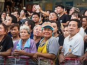 11 NOVEMBER 2016 - BANGKOK, THAILAND: Supporters of Yingluck Shinawatra wait to see their former Prime Minister. Yingluck was deposed in a coup in 2014, has started selling rice directly to Thai consumers. She buys the rice from farmers at market prices and then sells it to urban consumers at the price she paid. She said she's doing it to help out farmers, who are trying to deal with depressed prices. Yingluck is facing prosecution on corruption related charges going back to a rice price support scheme her government used to try to help farmers in 2011 and 2012. Even after the coup, she is still personally popular and hundreds of people showed up to see her at the rice distribution point at a mall in Samut Prakan province, in suburban Bangkok.   PHOTO BY JACK KURTZ