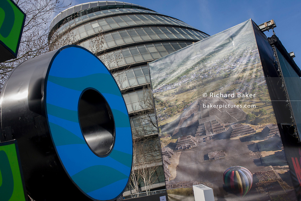 City Hall in the modern city of London and the ancient temple Teotihuacan in Mexico. The giant ad for Mexican tourism is a riverside poster by the offices of London's mayor. The holy city of Teotihuacan ('the place where the gods were created') is situated some 50 km north-east of Mexico City. Built between the 1st and 7th centuries A.D., it is characterized by the vast size of its monuments – in particular, the Temple of Quetzalcoatl and the Pyramids of the Sun and the Moon, laid out on geometric and symbolic principles. As one of the most powerful cultural centres in Mesoamerica, Teotihuacan extended its cultural and artistic influence throughout the region, and even beyond.