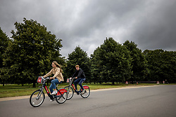 © Licensed to London News Pictures. 31/08/2021. London, UK. Members of the public wrap up as they relax in Hyde Park, London on a damp and grey day. Today, August 31st, is the last day of meteorological summer. Photo credit: Ben Cawthra/LNP