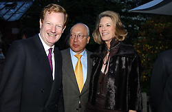 Left to right, the EARL OF DERBY and MR & MRS URS SCHWARZENBACH at the Cartier Chelsea Flower Show dinat the annual Cartier Flower Show Diner held at The Physics Garden, Chelsea, London on 23rd May 2005.<br /><br />NON EXCLUSIVE - WORLD RIGHTS