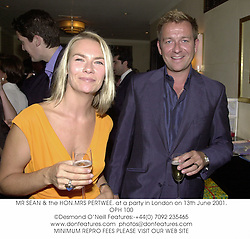 MR SEAN & the HON.MRS PERTWEE. at a party in London on 13th June 2001.<br />OPH 100