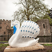 A statue of a swan outside the Bishop's Palace in Wells, Somerset, England.