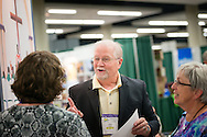 The Rev. John Fale, executive director of the LCMS Office of International Mission, meets participants from the 36th Biennial Convention of the Lutheran Women's Missionary League on Friday, June 26, 2015, at the Iowa Events Center in Des Moines, Iowa. LCMS Communications/Erik M. Lunsford