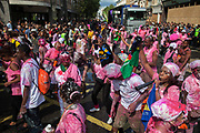 People covered in pink and white paint at the Notting Hill Carnival in West London. The Notting Hill Carnival is an annual event which since 1964 has taken place each August, over two days (the August bank holiday Monday and the day beforehand). It is led by members of the West Indian / Caribbrean community, particularly the Trinidadian and Tobagonian British population, many of whom have lived in the area since the 1950s. The carnival has attracted up to 2 million people in the past, making it the second largest street festival in the world. The celebration centres around a parade of floats, dancers and sound systems.