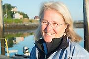senior scientist Dr. Moira Brown at New England Aquarium pier on Passamaquoddy Bay at Lubec Island, Maine, USA,  Bay of Fundy, North Atlantic