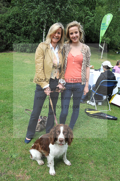 MICHELLE CADBURY and her daughter JEMIMA CADBURY and their dog Bert at the Macmillan Dog Day in aid of Macmillan Cancer Support held at the Royal Hospital Chelsea, London on 8th July 2008.<br /><br />NON EXCLUSIVE - WORLD RIGHTS